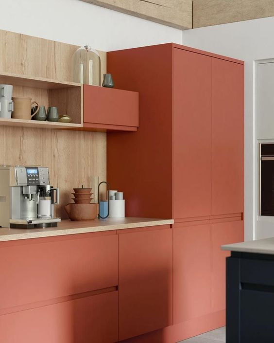 a minimalist terra cotta kitchen with wooden countertops and a backsplash looks bold and very eye catchy