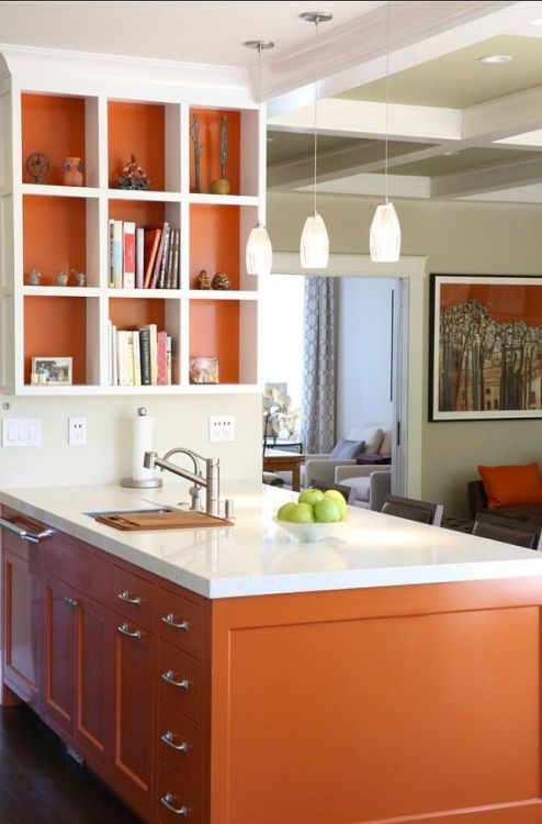 a modern burnt orange kitchen with white stone countertops and a matching open shelving unit plus pendant lamps