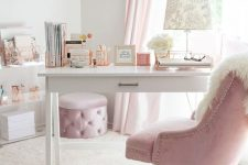 a neutral refined home office with light pink curtains, a lilac ottoman and a light pink chair, faux fur and metallic touches