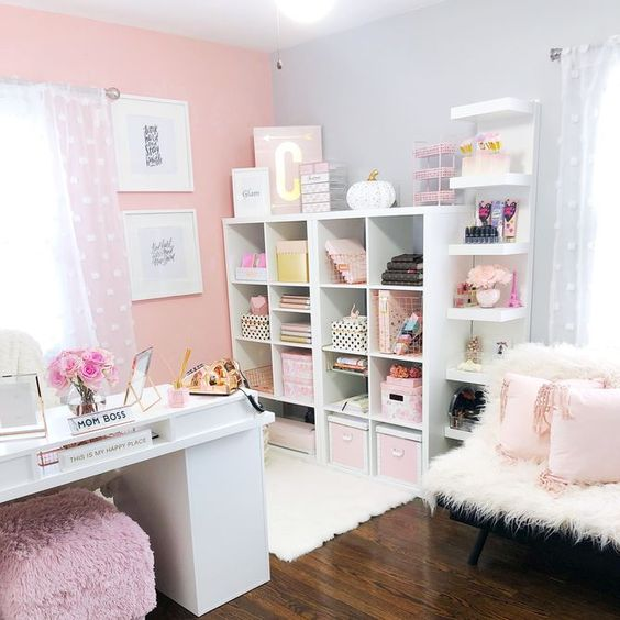 a refined girlish home office with a pink accent wall, pink accessories and furniture and touches of gold for more glam