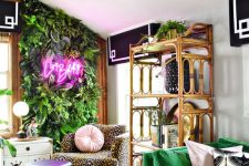 a super bold and fun home office with a greenery wall with a neon light, an emerald sofa, a leopard print chair and an acrylic stool