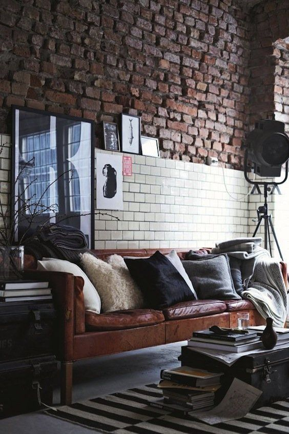 an industrial space with a brown leather Stockholm sofa that brings style and a touch of chic and cool color