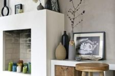 08 a modern non-working fireplace with colorful candles inside looks bold and fun and sticks to the style of the room