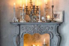 18 a whitewashed refined fireplace with various candles inside and on the mantel looks gorgeous and creates a mood