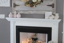 22 a non-working fireplace with faux fur, fabric pumpkins and lights all over plus firewood around it