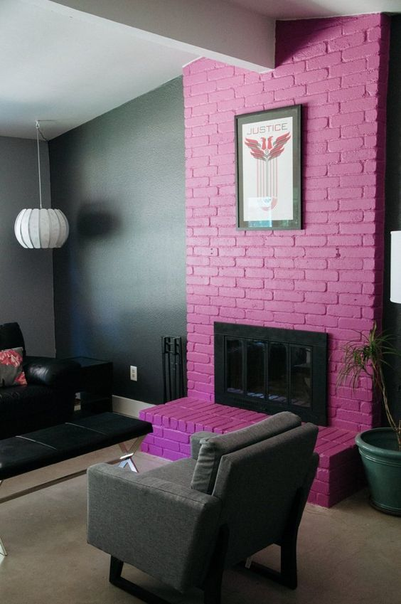 a moody living room accented with a purple brick fireplace and an artwork for a gorgeous statement