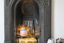 25 a Victorian fireplace with a large candle, firewood with lights looks modern, fresh and catchy