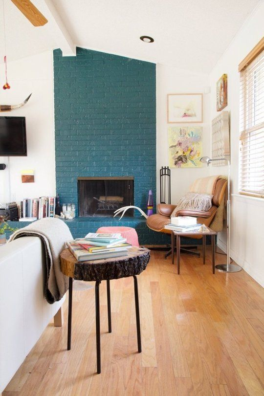 a teal brick fireplace, even a non-working one, is a very non-traditional decor feature to go for
