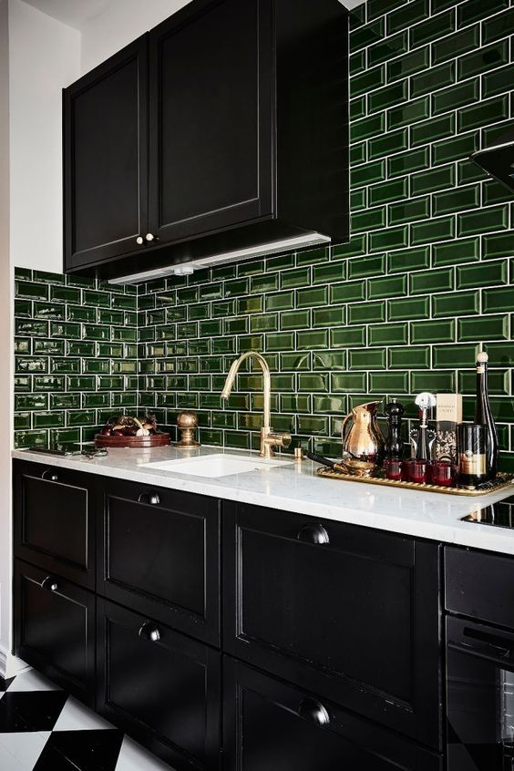 a bold black and white kitchen with glossy green subway tiles for a touch of color is very cool
