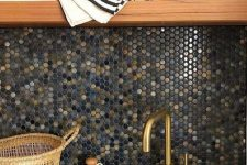 a bold dark blue, gold and grey penny tile backsplash will bring much color and texture to any kitchen