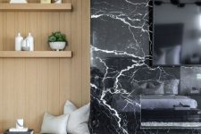 a chic mid-century modern space with a black marble fireplace and a wood clad niche with shelves next to it