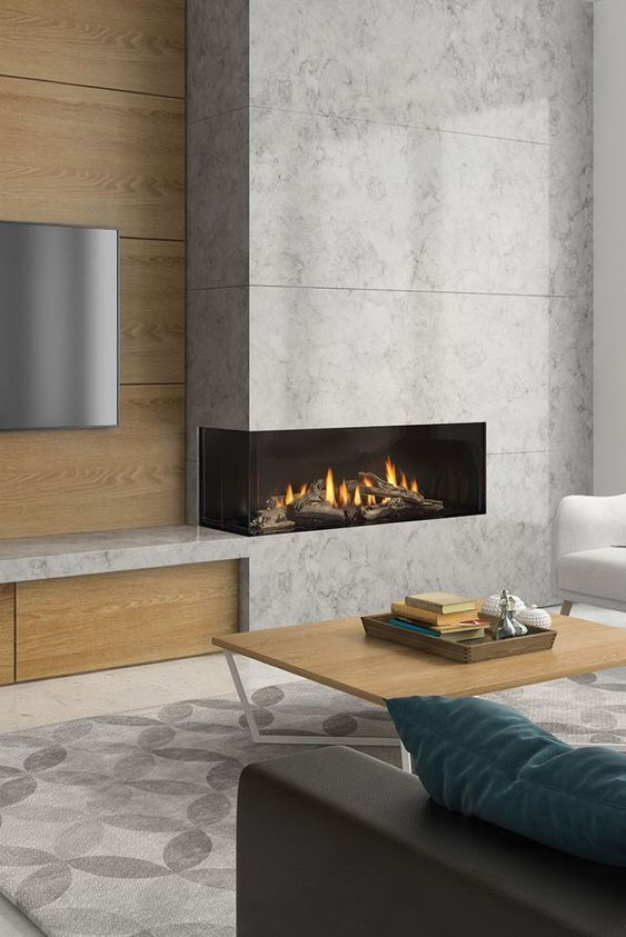 a chic minimalist living room with a corner concrete fireplace and stylish furniture is very elegant and cool