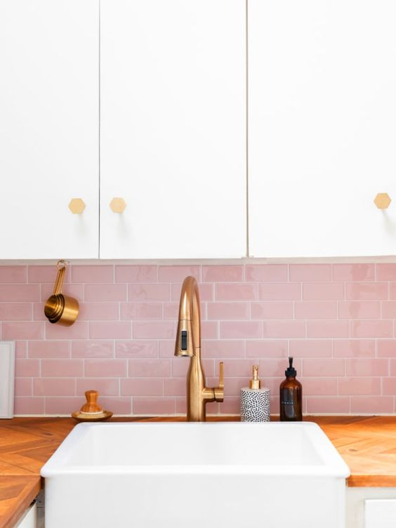 a chic neutral kitchen with a pink subway tile backsplash and touches of gold for a glam and cute look