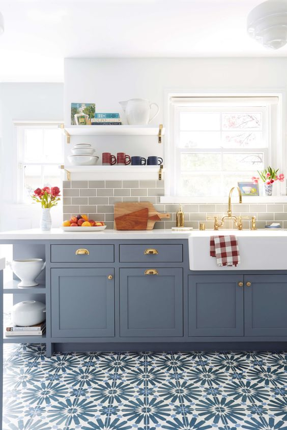a chic slate grey farmhouse kitchen with a grey subway tile backsplash and a mosaic tile floor is elegant
