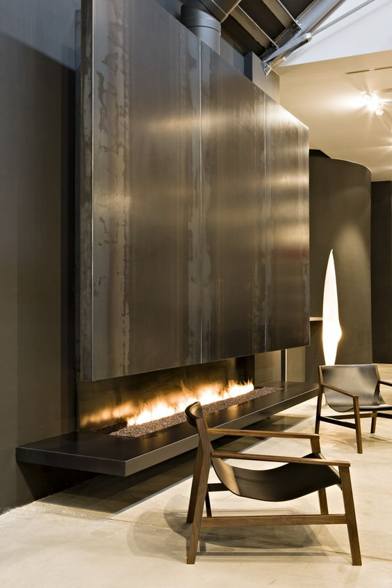 a gas fireplace clad with sleek metal is a bold statement feature for any contemporary space