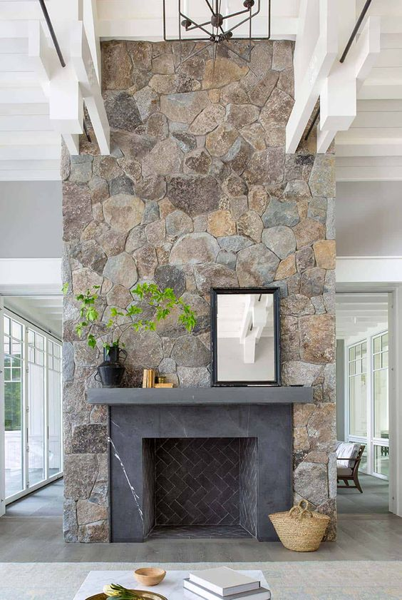 a large stone fireplace with the fireplace itself clad with grey marble is a bold farmhouse piece that brings coziness