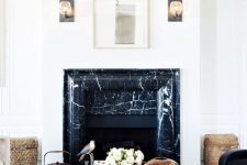 a luxurious living room with a faux fireplace clad with black marble that brings more chic to the space