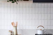 a minimalist kitchen design with a tiled backsplash
