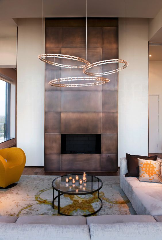a modern fireplace clad with darkened copper looks really wow and impressive and will make a statement in the space
