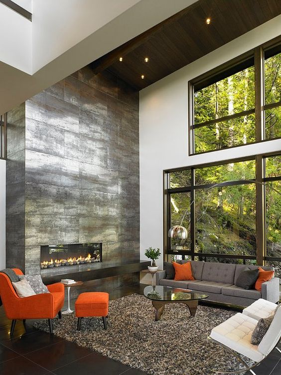 a shiny sleek metal fireplace that takes a whole wall will become a centerpiece of any living room and make it bolder