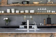 an industrial kitchen design with a tile backsplash