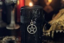 02 a black candle with black drip, a star pendant on a black ribbon is a stylish witches' inspired idea