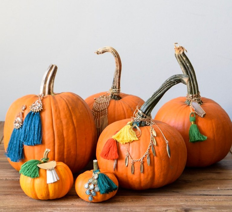 pumpkins decorated with tassels, hangings, crystals, fringe and jewels look very chic and boho-like