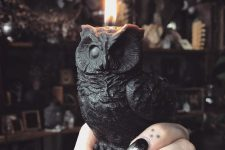 03 a black owl candle is a stunning idea for Halloween, rock it for decorating your spaces