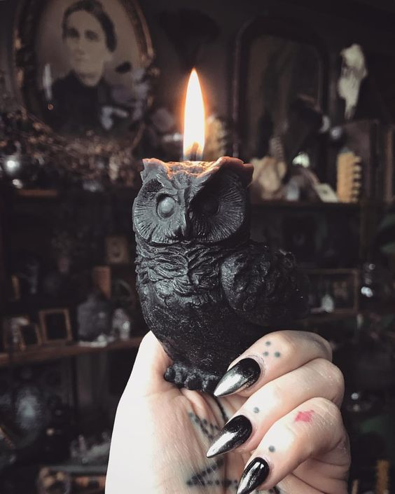 a black owl candle is a stunning idea for Halloween, rock it for decorating your spaces