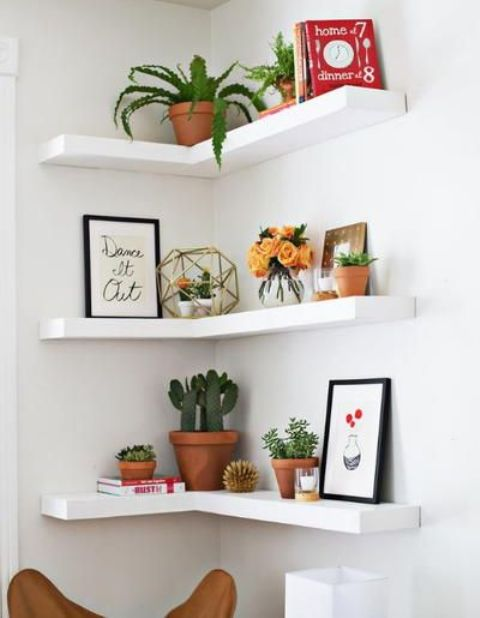 such open corner shelves can be easily DIYed for your space and you'll use your awkward corner (or you could simply buy IKEA LACK shelves and hack them)