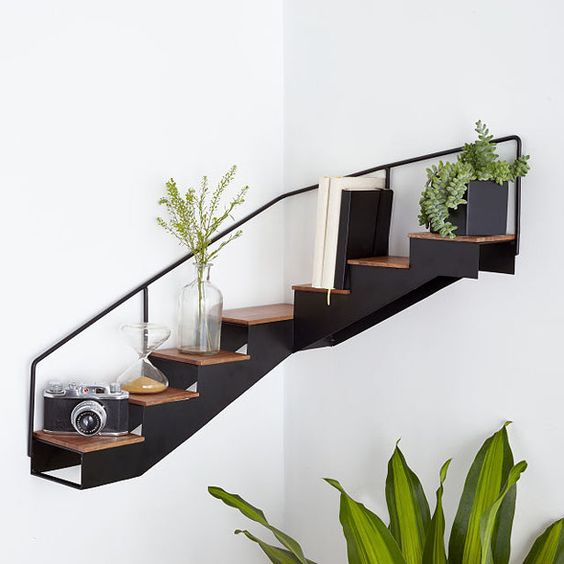 a very creative staircase corner shelf allows you to store and display a lot of stuff and looks awesome