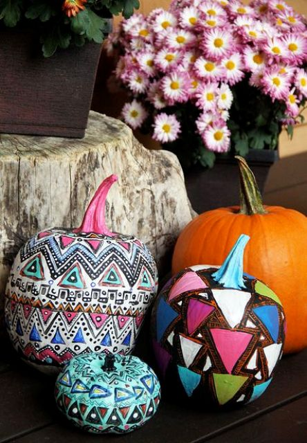 don't be afraid to go bold, try various tribal and gypsy patterns and bold colors for pumpkin decor
