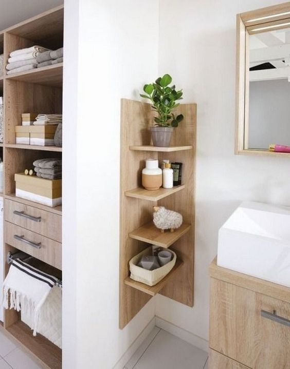 a comfortable wooden shelving unit with a base is ideal for a contemporary or minimalist bathroom