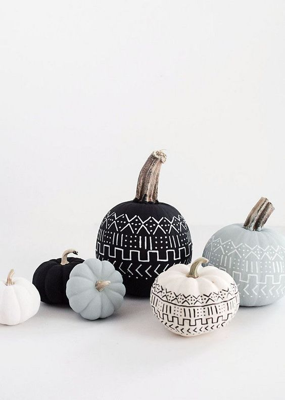 folksy pumpkins painted black, white and grey with decorated with folk patterns using sharpies