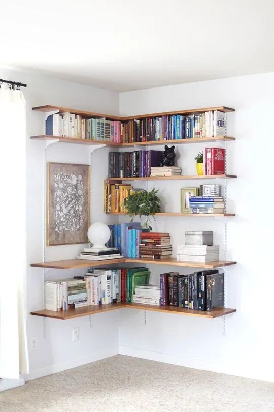 a large open shelving unit covering the corner is a lovely idea to use this space and make the use of it