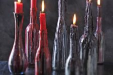 07 black bottles with red and deep purple wax from candles on them look scary and bloody, so you won't have to decorate the holders too much