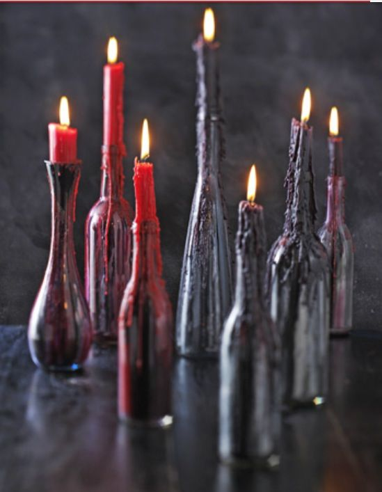 black bottles with red and deep purple wax from candles on them look scary and bloody, so you won't have to decorate the holders too much