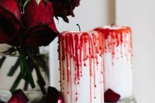 08 bloody candles, red roses placed on a book are nice for refined vampire-inspired decor
