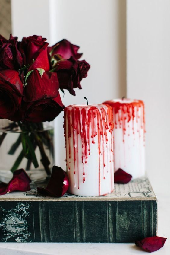 bloody candles, red roses placed on a book are nice for refined vampire-inspired decor