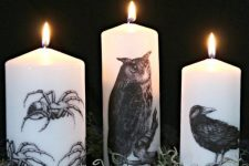 12 simple white candles deocrated with a tissue paper image transfer are stylish for Halloween
