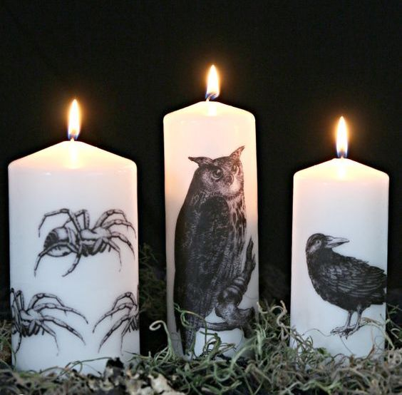 simple white candles deocrated with a tissue paper image transfer are stylish for Halloween