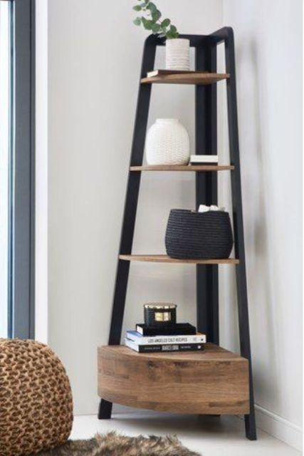 a corner shelving unit with rounded shelves and a closed storage space under them is a stylish piece for a modern space