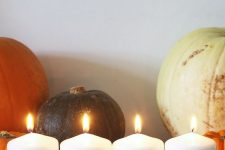 13 decorate simple white candles with a black sharpie making some scary faces and voila – you have Halloween candles