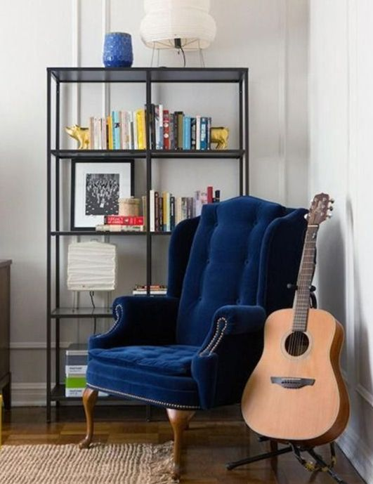 a stylish blue velvet wingback chair for adding a bright touch to the space and making it very stylish and chic