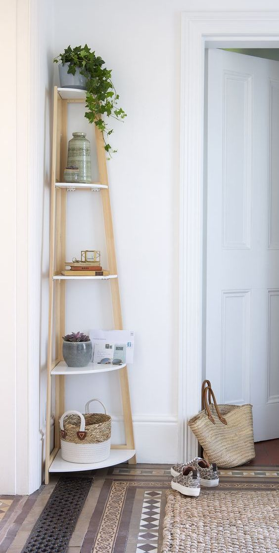 a stylish corner shelf with rounded shelves is great for the hallway, keeping all those essentials ready anytime you need them