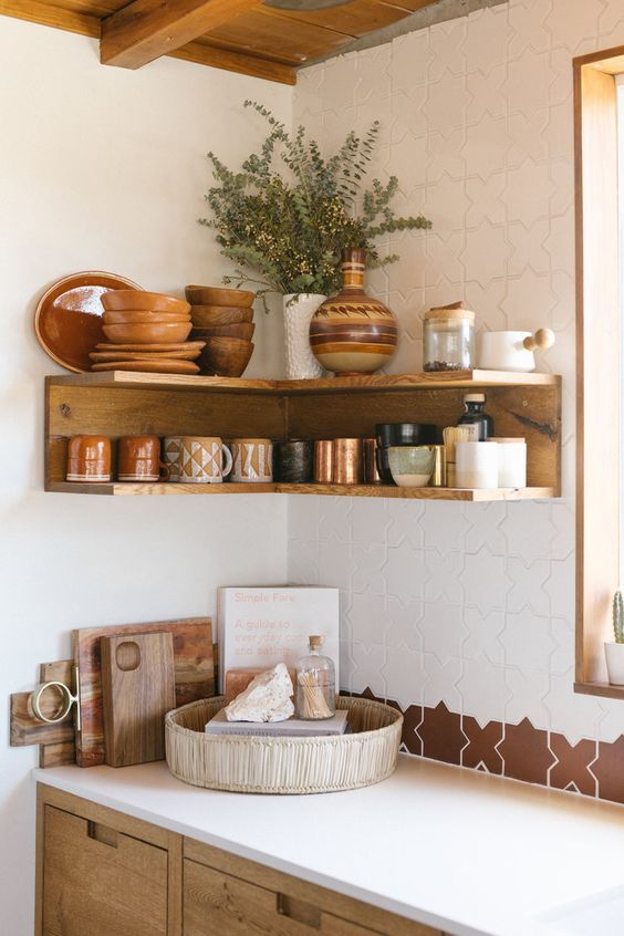 an open stained shelving unit in the corner will save much space for storing things in your kitchen like here