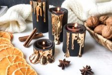 19 black candleholders with dripping gold will accommodate little tealights and will add elegance to your decor