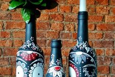 20 bottles painted with Mexican Day of the Dead sugar skulls can be used as candleholders or vases for blooms
