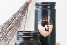 22 jars painted black with skull stencils on them are a nice Halloween-like idea to rock and will fit a modern party