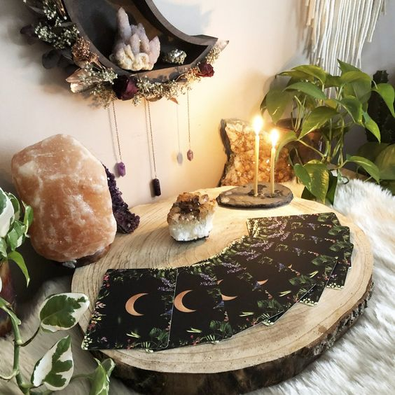 magical boho Halloween decor with tarot cards, crystals and geodes, candles and a lunar shelf with dried blooms